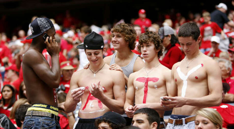 Katy High School students paint their chests before the start of  the Katy v. Wylie, 5A Division II championship game. Photo: Karen Warren, Chronicle