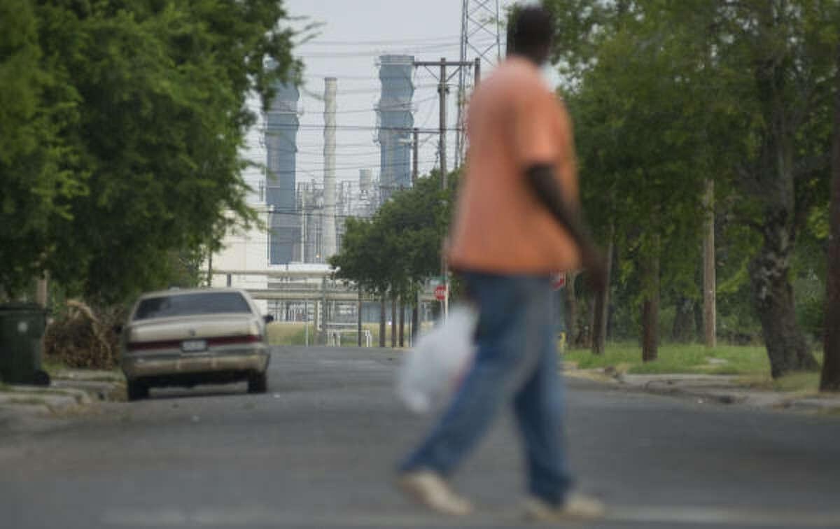An area resident walks along Van Loan Avenue, near the Corpus Christi Citgo refinery.