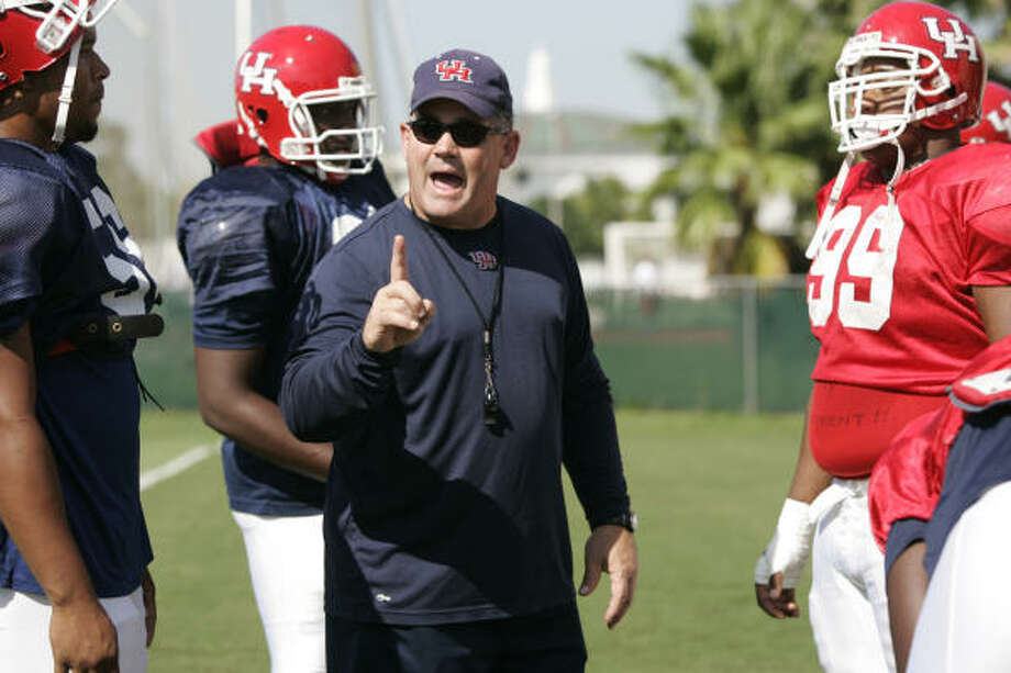 Current University of Houston defensive line coach Tony Fitzpatrick, center, wants to be considered for the Cougars' football coaching vacancy and has a plan that includes bringing in Art Kehoe, former assistant head coach at Miami, as associate head coach. Photo: BRETT COOMER, CHRONICLE