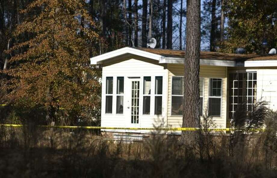 Investigators have roped off a home on Olive Branch Lane in New Hill, N.C., where the body of Apex High School student Matthew Silliman was found on Dec. 3. Photo: Corey Lowenstein, MCT
