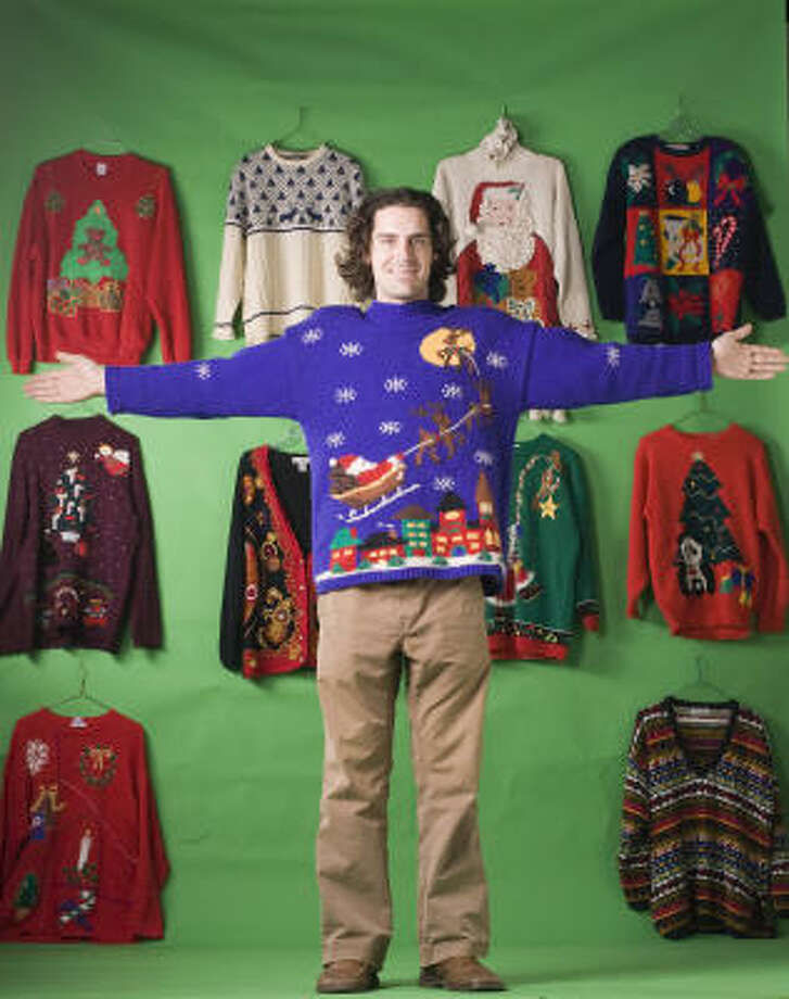 Matthew Wettergreen poses with some of his Christmas sweaters. Photo: Sharon Steinmann, Chronicle