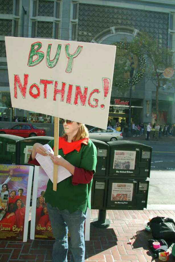 "William Rees of the University of British Columbia reports that human society is in a ìglobal overshoot,î consuming 30 percent more material than is sustainable from the worldís resources. Pictured: A ""Buy Nothing Day"" activist leaflets in San Francisco. Photo courtesy of Steve Rhodes. Photo: Contributed Photo"