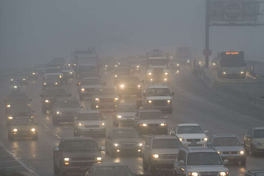 Dense fog shrouds traffic on Interstate 10 headed into downtown Thursday, Dec. 18, 2008, in Houston. Photo: Smiley N. Pool, Chronicle