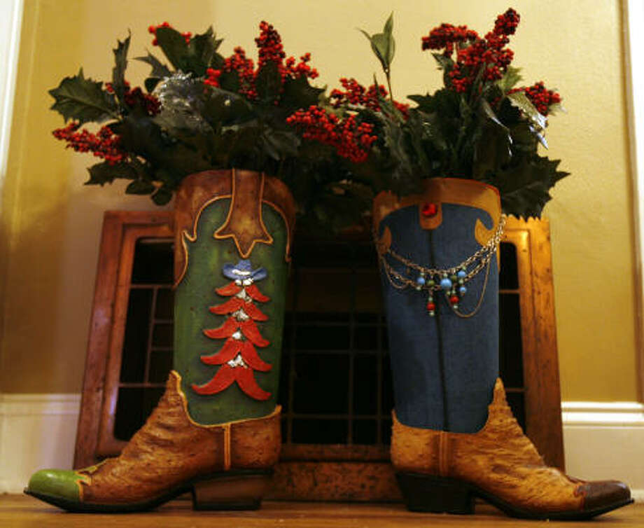 Cowboys boots are among the Christmas decorations at the home of Jennifer Emshoff Photo: Sharon Steinmann, Chronicle