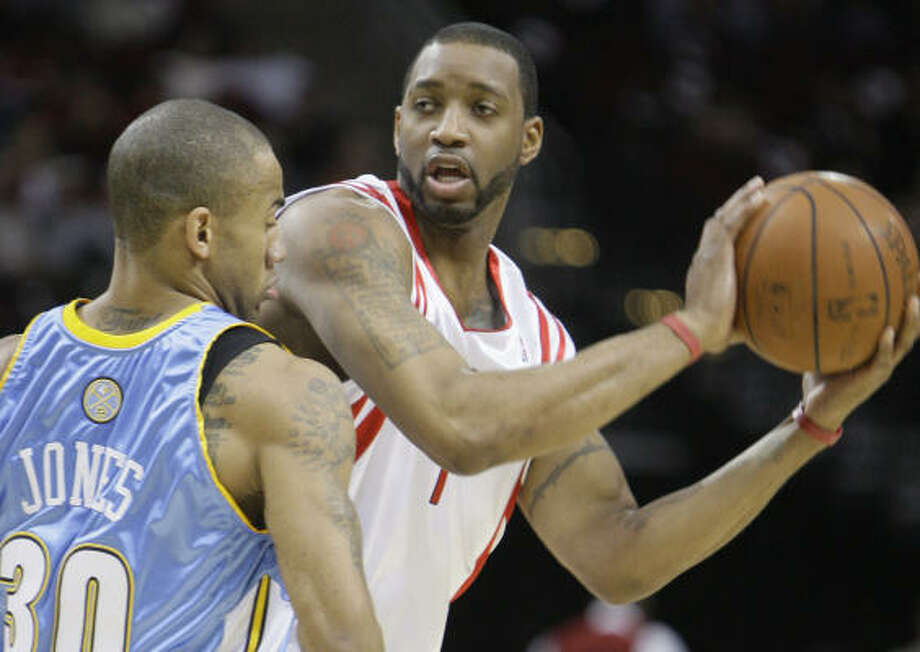 Rockets guard Tracy McGrady (right) recorded his fourth career triple-double with 20 points, 14 rebounds and 10 assists in Tuesday's 108-96 win over the Denver Nuggets. Photo: Melissa Phillip, Chronicle