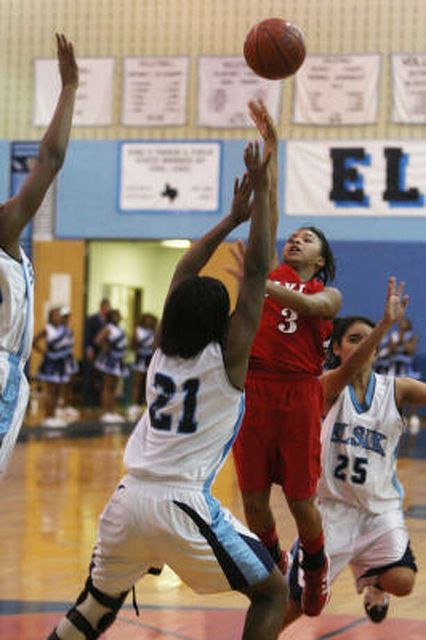 Alief Taylor's Victoria Williams shoots over Elsik's Destini Texada during Friday's game at Elsik High School. Elsik won 70-66. Photo: Margaret Bowles, For The Chronicle