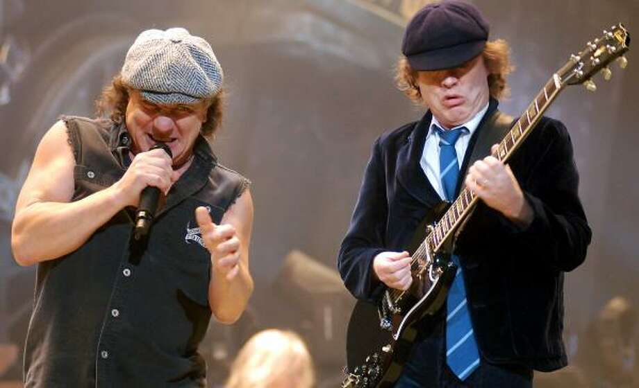Singer Brian Johnson and guitarist Angus Young of AC/DC perform Sunday night at Toyota Center. For more, go to blogs.chron.com/handstamp. Photo: DAVE ROSSMAN, SPECIAL TO THE CHRONICLE
