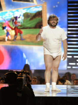 Host Jack Black gives a thumbs up during a performance at the awards show. Photo: Chris Pizzello, AP