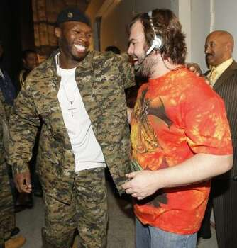 Performer 50 Cent, left, and Jack Black share a laugh backstage at the awards show. Photo: Chris Polk, AP