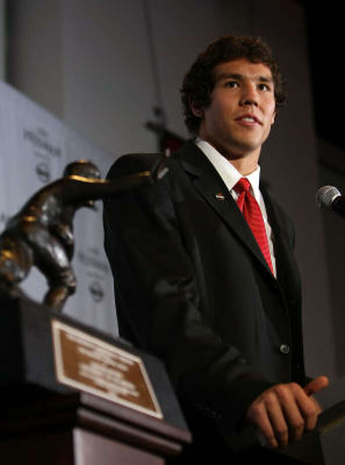 Sam Bradford of the Oklahoma Sooners talks with the media at a press conference after winning the Heisman Trophy. Photo: Nick Laham, Getty Images