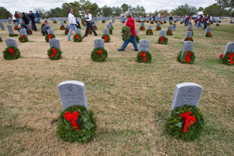 Nearly 12,000 wreaths were placed on grave stones as a part of Wreaths Across America Saturday at Houston National Cemetery. Photo: Nick De La Torre, CHRONICLE