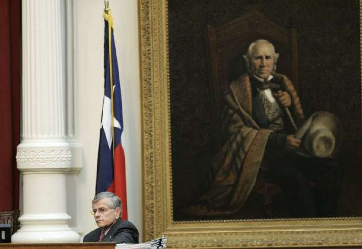Texas House Speaker Tom Craddick, R-Midland, sits near a portrait of Sam Houston and listens as speakers call for him to resign during the evening session in the Texas House of Representatives early Monday.