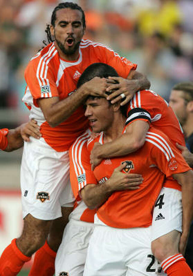 April 2, 2006:Dwayne De Rosario (top left) tied an MLS record with four assists — all on goals to Brian Ching (front) — in the Dynamo's inagural game in Houston. The Dynamo defeated the Colorado Rapids 5-2. Photo: James Nielsen, Chronicle