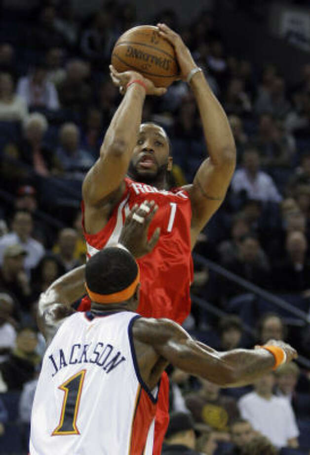 Rockets guard Tracy McGrady (top) had 24 points, 10 rebounds and nine assists in Friday's 119-108 win over the Golden State Warriors in Oakland, Calif. Photo: Ben Margot, AP
