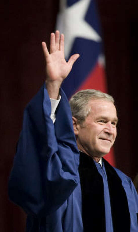 President George W. Bush waves as he arrives at the inaugural winter commencement convocation at Texas A&M University where he gave the keynote speech on Friday, Dec. 12, 2008, in College Station. Photo: Brett Coomer, Chronicle