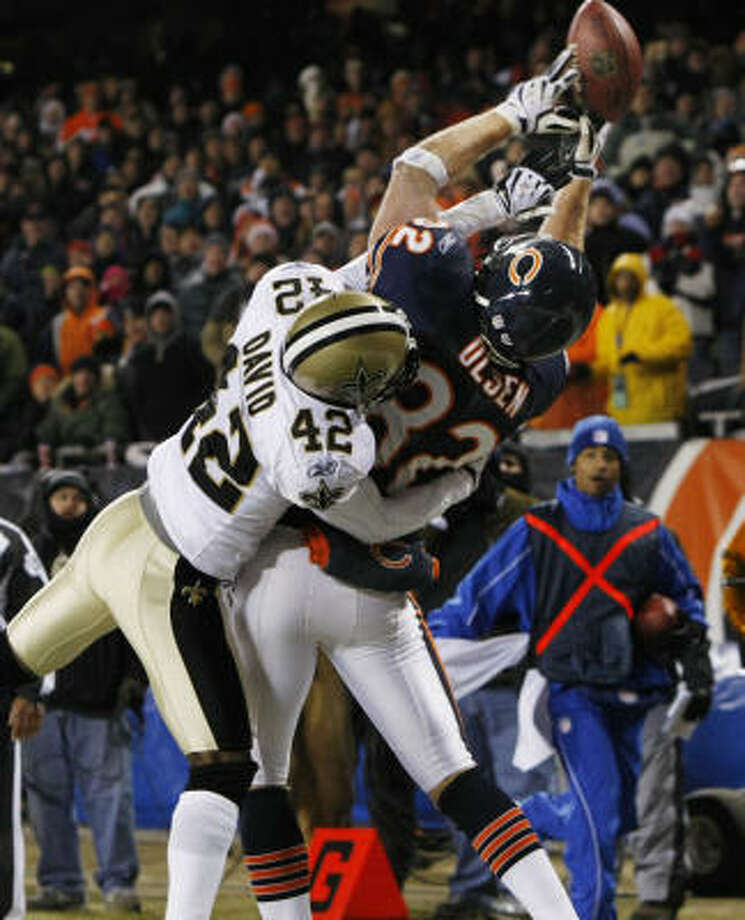 Bears 27, Saints 24 New Orleans Saints cornerback Jason David breaks up a pass in the end zone intended for Chicago Bears tight end Greg Olsen. Photo: Gerald Herbert, AP