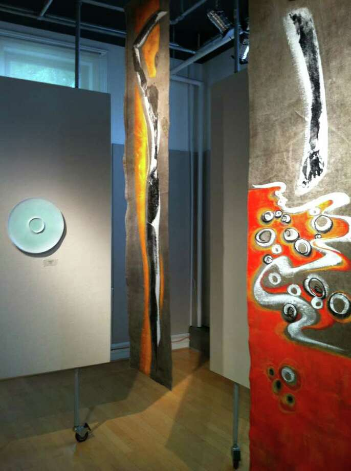 AnnaSofia Maag's 'Paradise,' on the left, and several of the panels that represent Sofi Ruotsalainen's 'Bodyscapes,' are among the works at the 'Arctic Women and their Art' show, which is on display through Aug. 27 at the Greenwich Arts Council. Photo: Contributed Photo