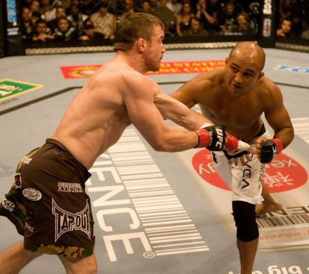 BJ Penn, right, lost to Matt Hughes as a welterweight, but is hoping to resurect his career as a lightweight.