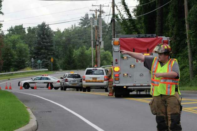 Schoolhouse Road in Guilderland was closed to traffic at Country Road Wednesday, Aug. 10, 2011, as safety crews tackled a gas leak on the Thruway near Schoolhouse Road in Guilderland.  Both lanes of the Thruway between exits 23 and 24 were shut down until emergency workers could seal the leak. (Will Waldron / Times Union) Photo: Will Waldron