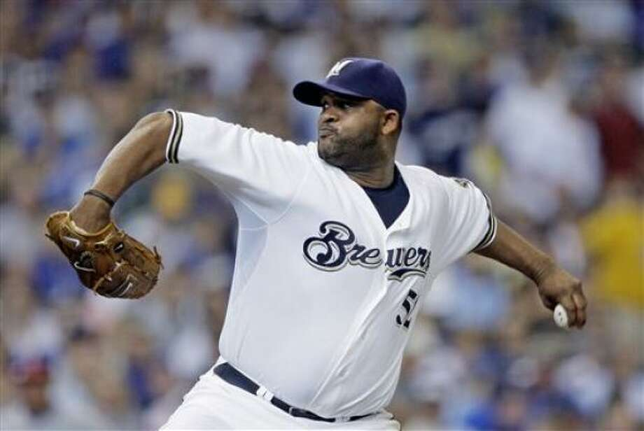 CC Sabathia to the Yankees:Signing for seven years and $161 million, a record for a pitcher. Photo: Morry Gash, AP