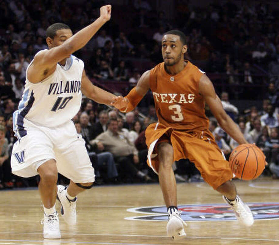 Texas' A.J. Abrams, right, scored a game-high 26 points to help the Longhorns knock off Villanova 67-58 in the Jimmy V Classic on Tuesday night at Madison Square Garden in New York. Photo: Julie Jacobson, AP