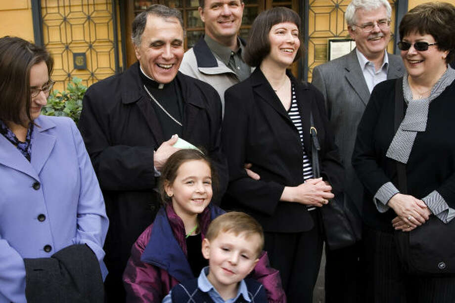 Daniel N. DiNardo, Archbishop of the Archdiocese of Galveston-Houston, laughs with his family as they gather to take a group photo before their Thanksgiving lunch at Taverna Giulia in Rome on Thursday. With him, from left, are niece Holly Riley, grand-niece Fiona Riley, 6, and grand-nephew Quinn Riley, 4, sister Mary Anne Hornyak and her husband Steve Hornyak, sister Peg Riesmeyer and her husband Ron Reismeyer. Photo: Smiley N. Pool, Chronicle