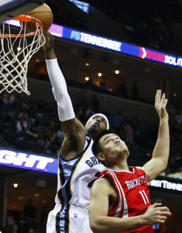 Grizzlies forward Hakim Warrick, back, makes it look easy on this basket against Yao Ming in the third quarter. Photo: Mark Weber, AP