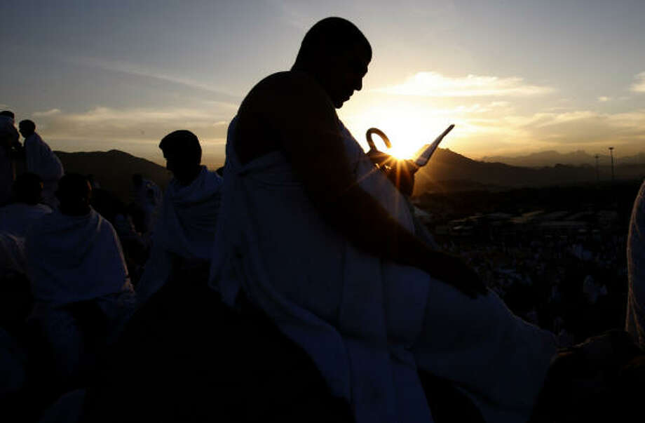 A Muslim pilgrim prays on a rocky hill called the Mountain of Mercy, on the Plain of Arafat near Mecca, Saudi Arabia, Sunday. Photo: Hassan Ammar, AP