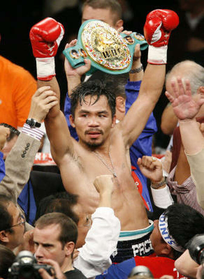WBC lightweight champion Manny Pacquiao celebrates his victory over Oscar De La Hoya. Photo: Eric Jamison, AP