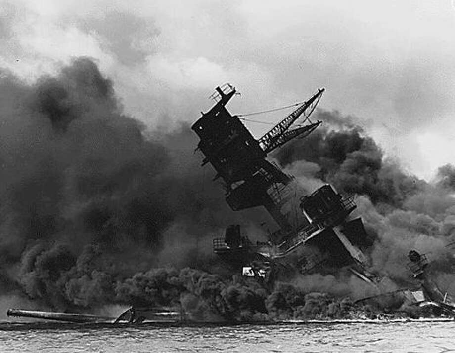 This US Navy file image shows the USS Arizona afire and sinking after the Japanese attack on Pearl Harbor on Dec. 7, 1941. Photo: AFP/Getty Images