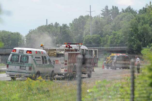 Safety crews respond to a gas leak on the Thruway near Schoolhouse Rd. Schoolhouse Rd. in Guilderland Wednesday lunchtime, Aug. 10, 2011. Both lanes of the Thruway between exits 23 and 24 were shutdown until emergency workers could seal the leak. (Will Waldron / Times Union) Photo: Will Waldron