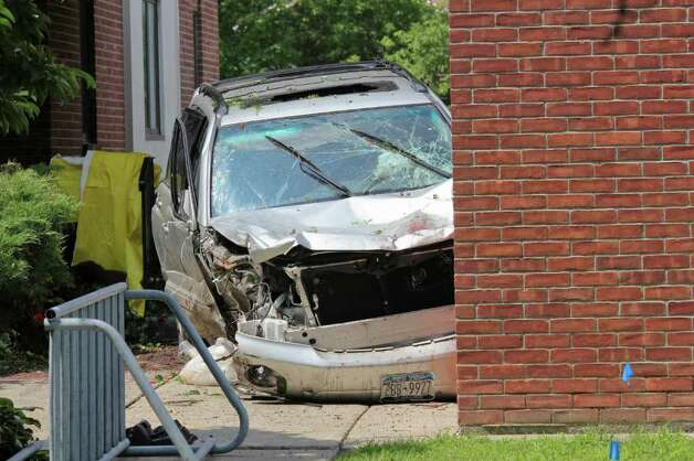 A crashed SUV at St. Matthew's church on Mountain View Street in Voorheesville on Wednesday, Aug. 10, 2011. The accident resulted in the deaths of three people. The driver alleges that her flip flop was caught under the accelerator of the car. (Erin Colligan / Special To The Times Union)