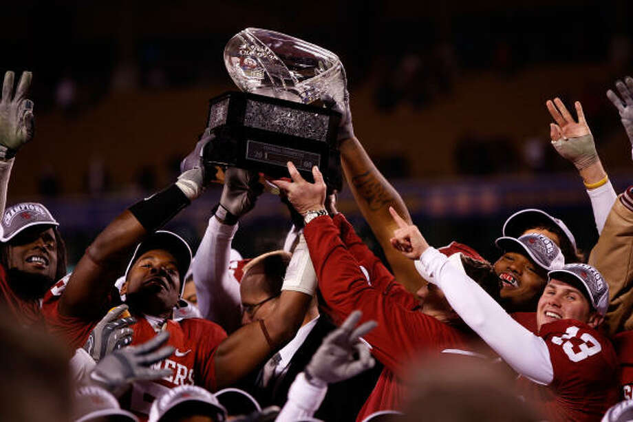 Oklahoma 62, Missouri 21 The Oklahoma Sooners celebrate with the trophy after the Sooners defeated the Missouri Tigers to win the Big 12 Championship game. Photo: Jamie Squire, Getty Images