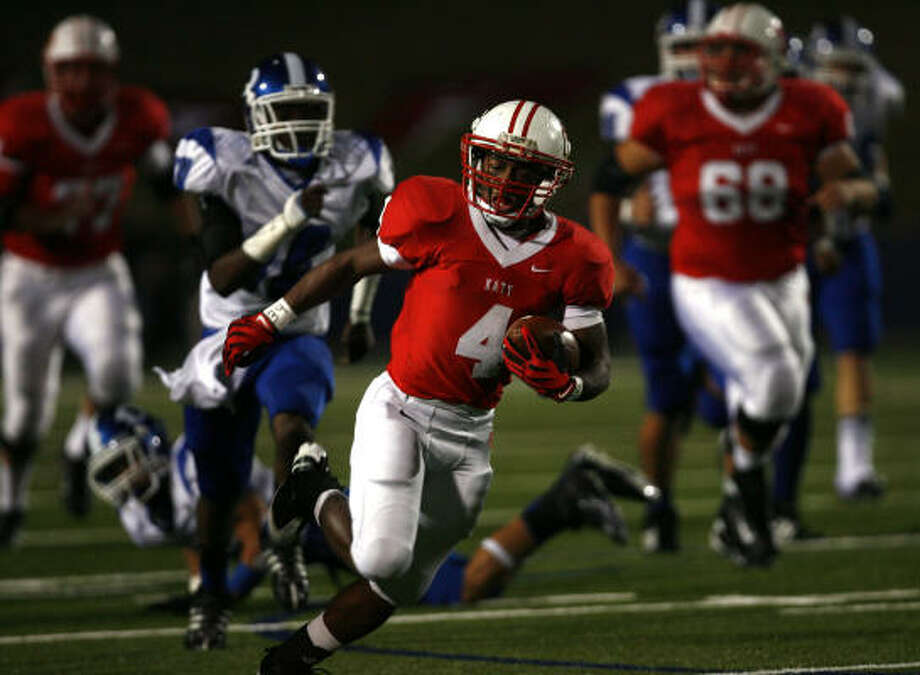 Katy 38, Dickinson 7 Katy's Will Jeffery runs the ball in the first half against Dickinson at Tully Stadium. Photo: Sharon Steinmann, Chronicle