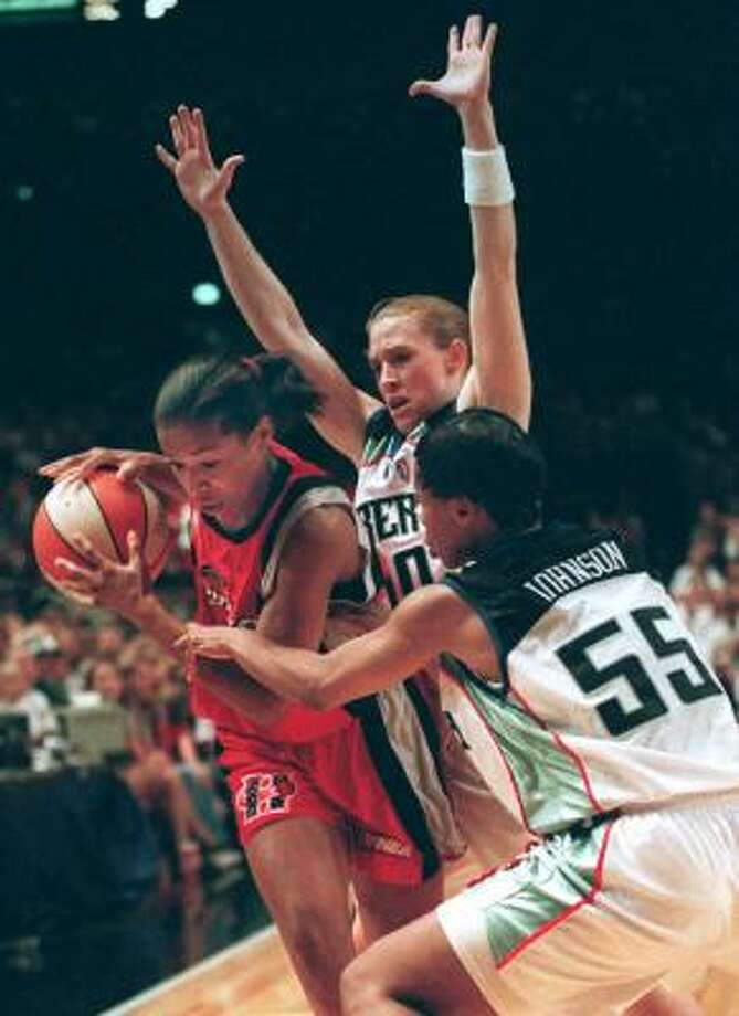 1997 Record: 18-10 The Comets win the title in the inaugural season of the WNBA after beating the New York Liberty in the one-game final.Above, Cynthia Cooper is guarded by New York Liberty's Vickie Johnson (55) and Rhonda Blades during the cahmpionship game. Photo: EMILE WAMSTEKER, AP