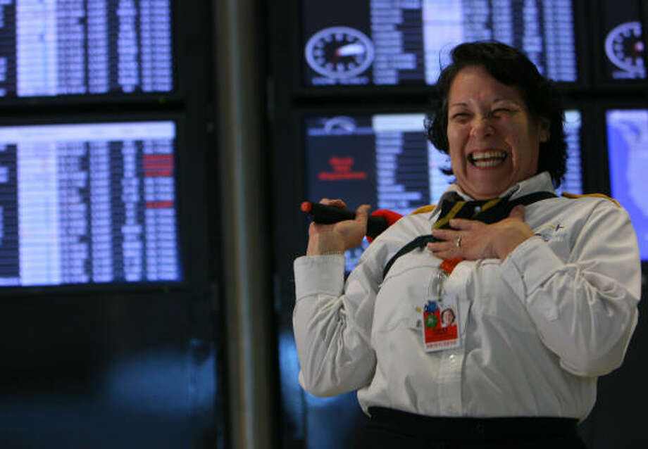 Amanda Tobias, a George Bush Intercontinental Airport employee, sings during the Holiday Karaoke event Thursday in Houston.  Bush Intercontinental and William P. Hobby airports will offer the service over the next several weeks. Photo: Mayra Beltran, Chronicle