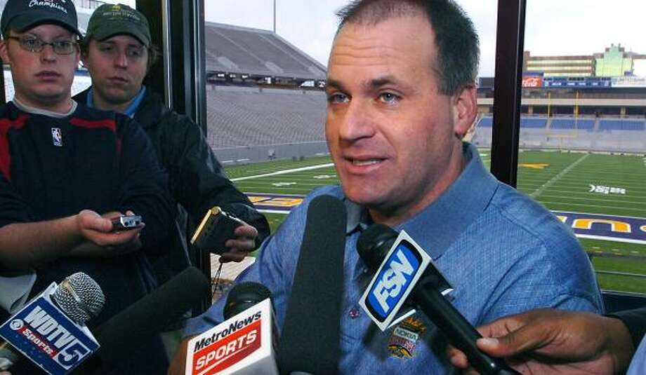 Rich Rodriguez will be wearing blue and yellow for the Wolverines, not the Mountaineers, in 2008. Photo: Jason DeProspero, AP