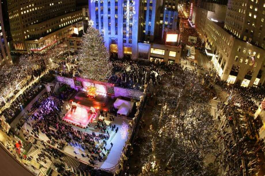The Rockefeller Center Christmas tree stands lit. The 80-year-old Norway spruce, which stands 72 feet tall, is decorated with 30,000 lights and topped with a Swarovski crystal star. Photo: Julie Jacobson, AP
