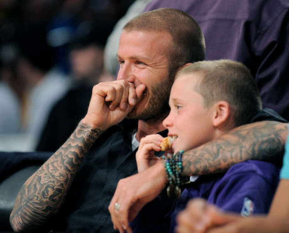 Here the Los Angeles Galaxy's David Beckham is seen with his son Brooklyn at Game 5 of the NBA basketball finals between the Los Angeles Lakers and the Boston Celtics, Sunday, June 15, 2008, in Los Angeles. Photo: Mark J. Terrill, AP