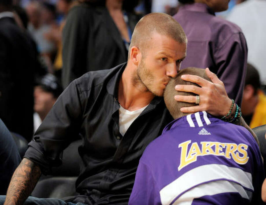 Los Angeles Galaxy soccer player David Beckham kisses his son Brooklyn during the second half of Game 5 of the NBA basketball finals between the Los Angeles Lakers and the Boston Celtics Sunday, June 15, 2008, in Los Angeles. Photo: Mark J. Terrill, AP