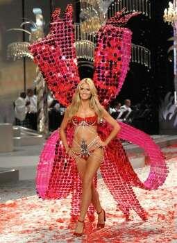 Model Heidi Klum walks the runway during Victoria's Secret Fashion Show. Photo: Evan Agostini, Associated Press