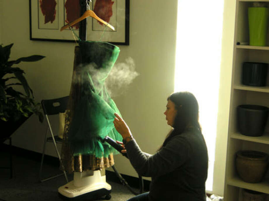 We began early in the morning, using a conference room as our staging area. One of the first chores fell to stylist Dawn Bell: steaming out the clothes.