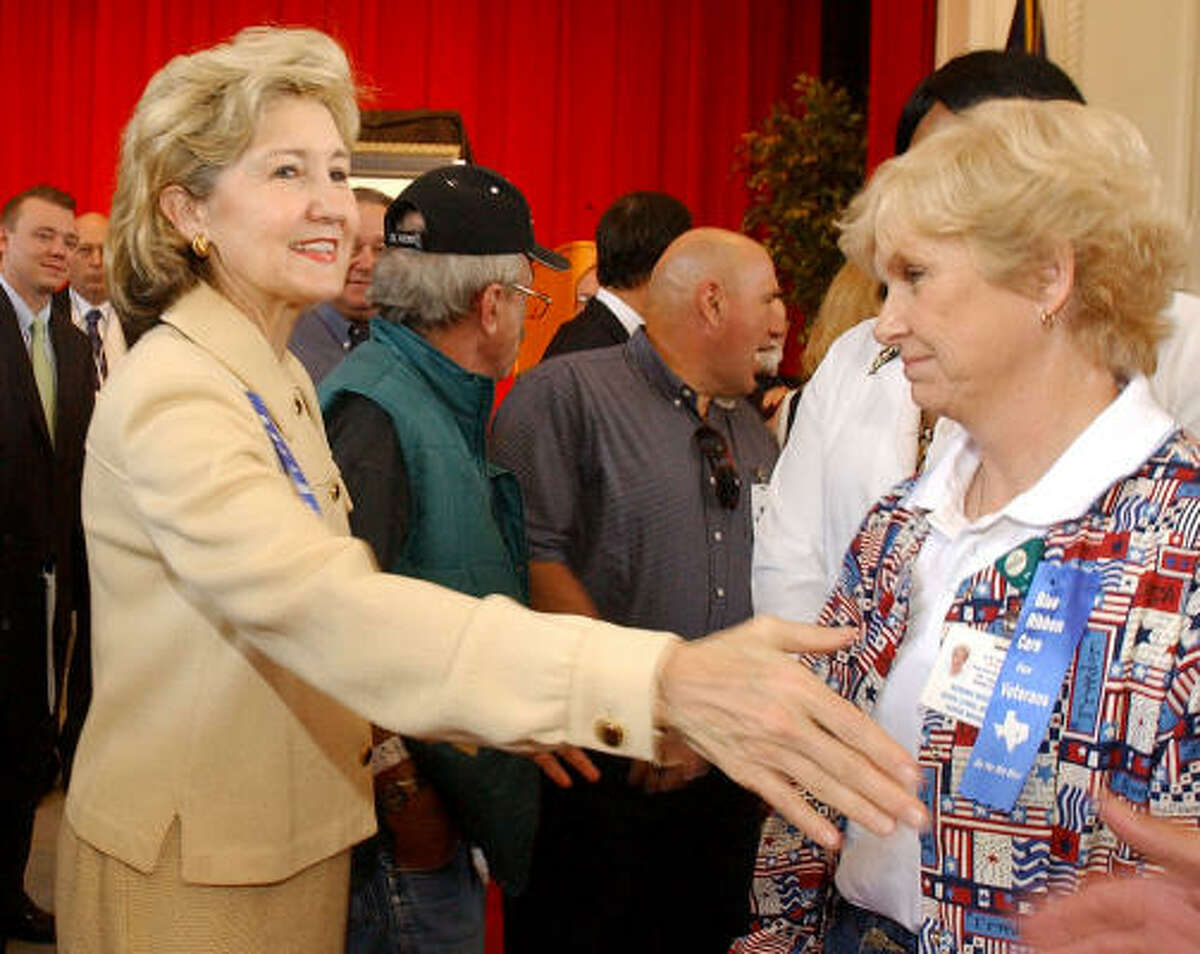 Sen. Kay Bailey Hutchison R-Texas, left, greets employees of the Waco Veterans Administration Hospital earlier this summer. She is considered a possible future contender for Texas governor.