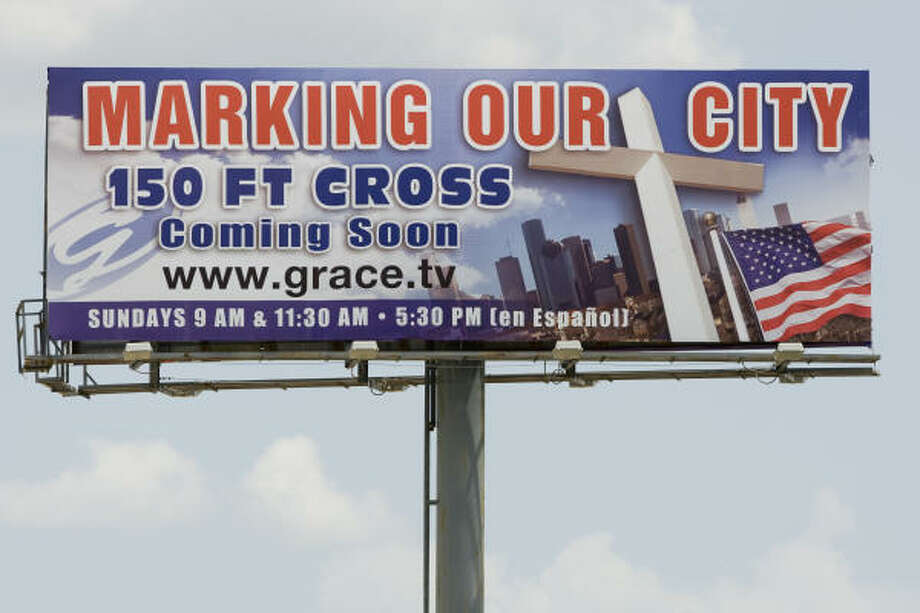 A billboard advertising a proposed cross to be built by Grace Church is shown on I-45 North on Tuesday. Should the city be marked with a cross? Other cities have been... Photo: Brett Coomer, Chronicle
