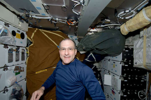 Astronaut Donald Pettit, STS-126 mission specialist, is seen in the middeck of Space Shuttle Endeavour on Nov. 14, Photo: NASA, AP