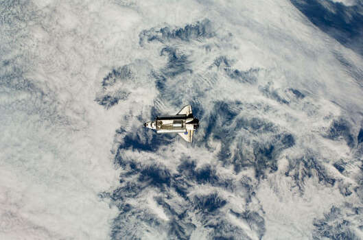 The Space Shuttle Endeavour approaches the International Space Station before docking. Photo: Handout, Getty Images