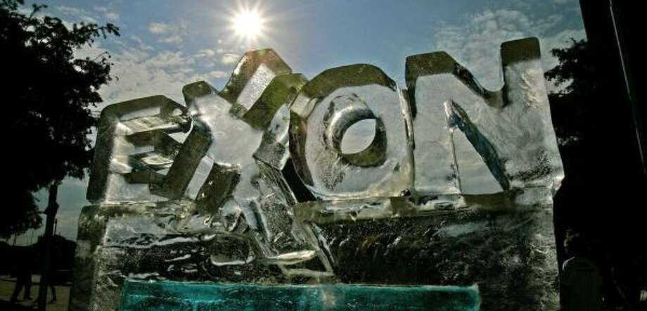 An ice sculpture fashioned by protesters melts outside an Exxon Mobil shareholders meeting in Dallas in May. Protesters had said the firm was helping to slow action against global warming. Photo: LM OTERO, ASSOCIATED PRESS FILE