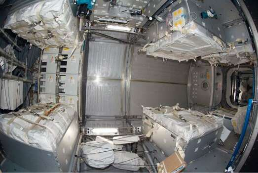 An interior view of the Leonardo Multi-Purpose Logistics Module after it was attached to the Earth-facing port of the International Space Station's Harmony node. Leonardo was moved from Space Shuttle Endeavour's cargo bay and linked to the station on Nov. 17. Photo: NASA, AP