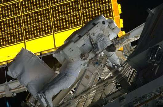 Astronaut Steve Bowen participates in the mission's first spacewalk Nov. 18. Photo: NASA, AP