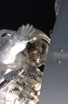 Astronaut Steve Bowen participates in the mission's fourth and final spacewalk on Nov. 24. During the six-hour, seven-minute spacewalk, Bowen and astronaut Shane Kimbrough, unseen, completed the lubrication of the port Solar Alpha Rotary Joints (SARJ) as well as other station assembly tasks. Photo: NASA, AP